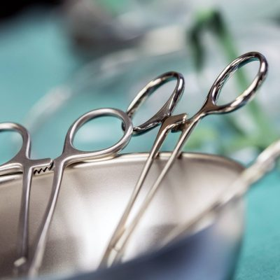Some scissors for surgery on a tray, conceptual image